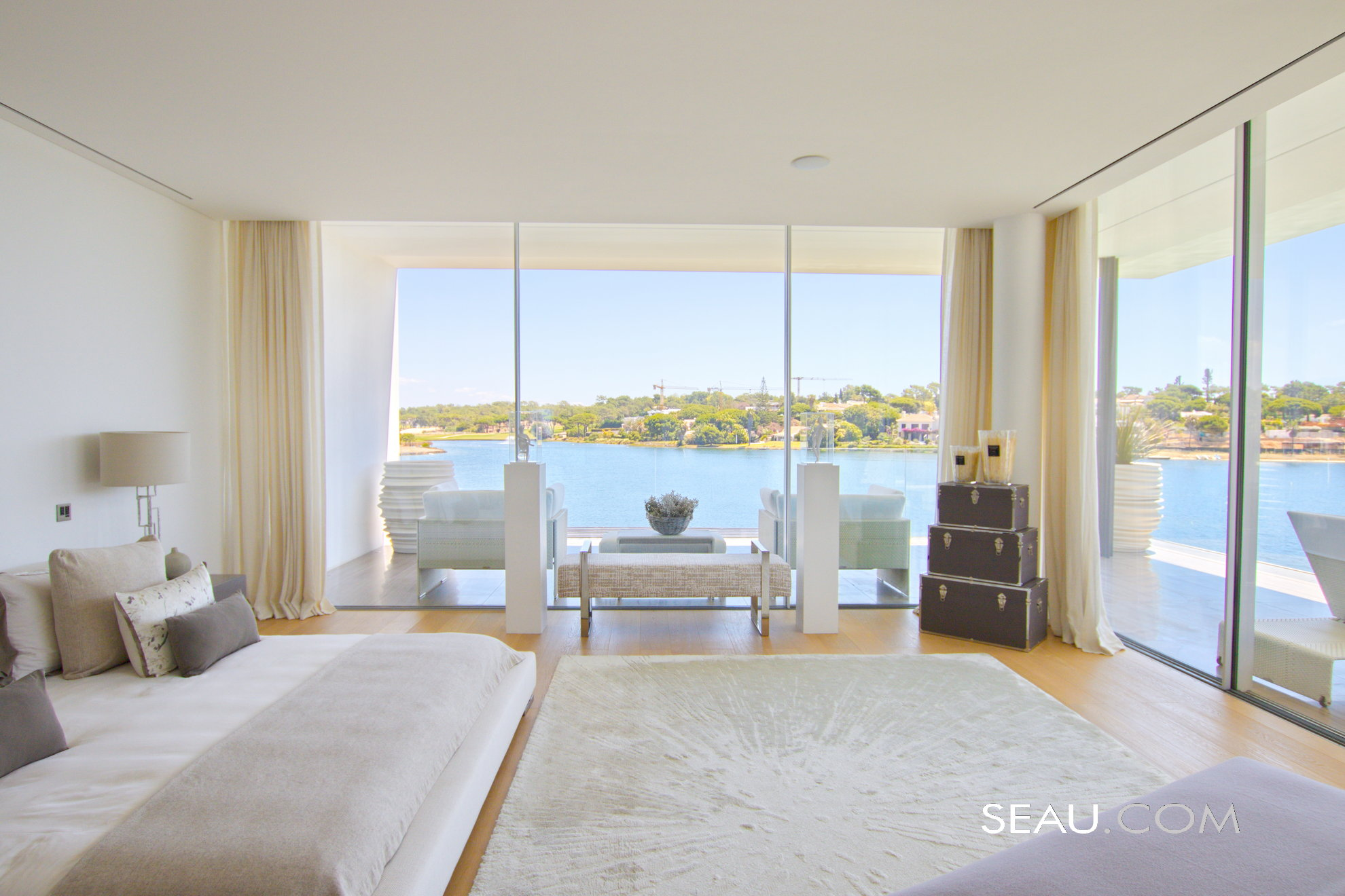 Master Suite with a breathtaking view and private terrace. This room also offers two large dressing rooms, a stylish bathroom with double sinks and a walk in rain shower.