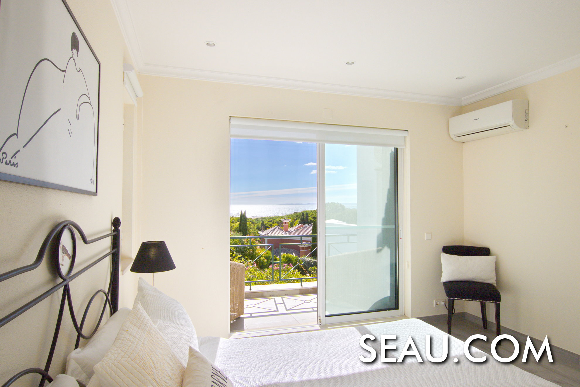 Upstairs guest bedroom with extraordinary sea views