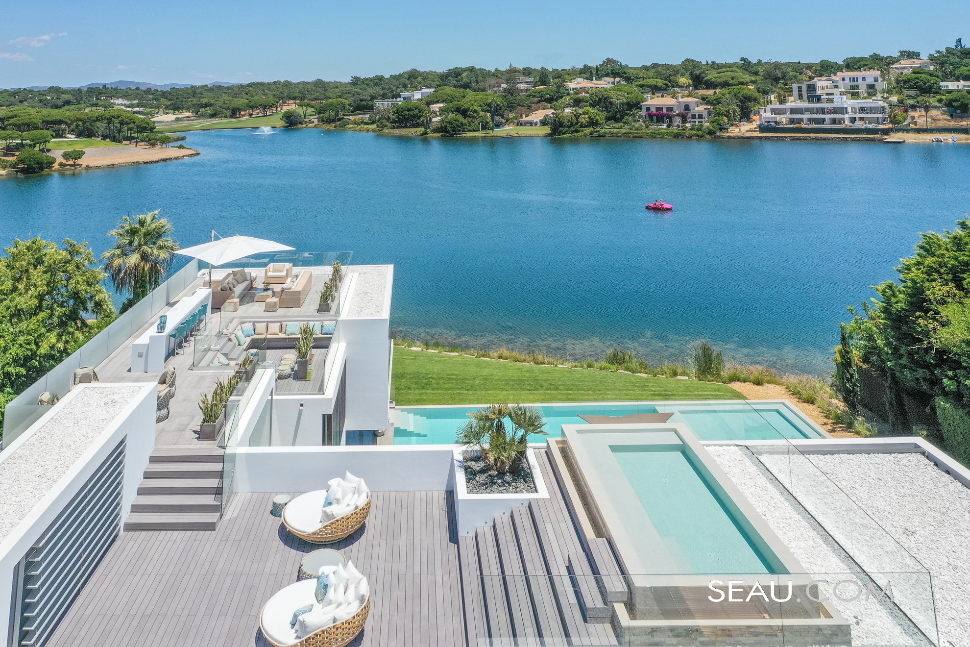 Roof top with a generous lounge area, fitted with outdoor kitchen, and infinity pool, and several sitting areas