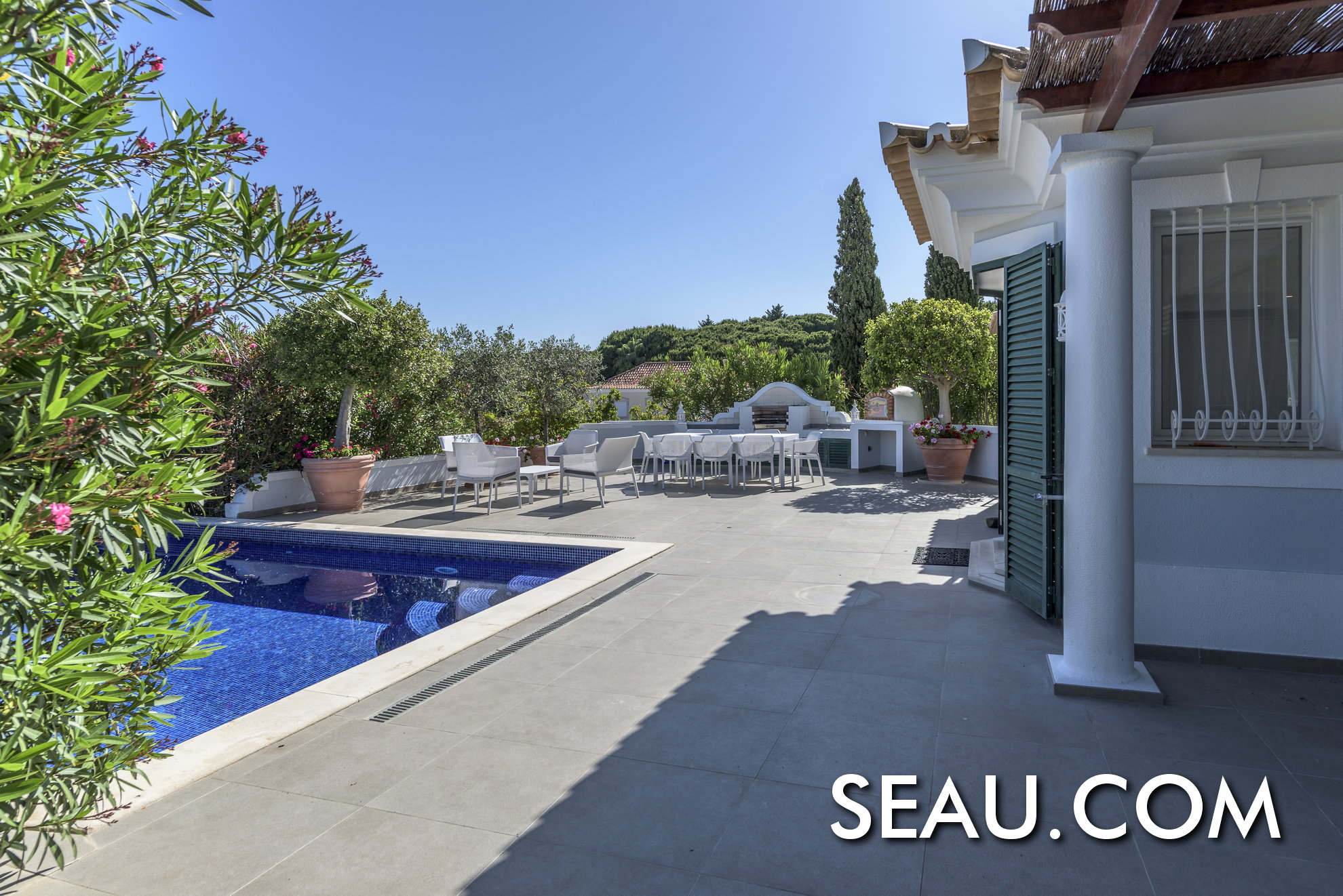 Large terrace with pool, barbecue and sitting area with stunning views over the sea and the Algarvian hills